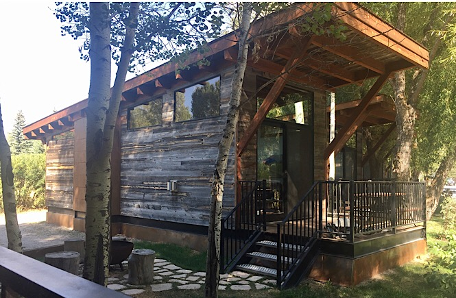 The Ultimate Road Trip to Yellowstone & Jackson Hole WY featured by top US family travel blog, More Than Main Street: Fireside Cabins in Jackson Wyoming on our Yellowstone trip
