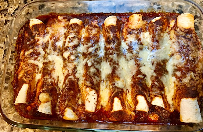 creamy chicken enchiladas with cream cheese, a recipe featured by top US lifestyle blog, More Than Main Street