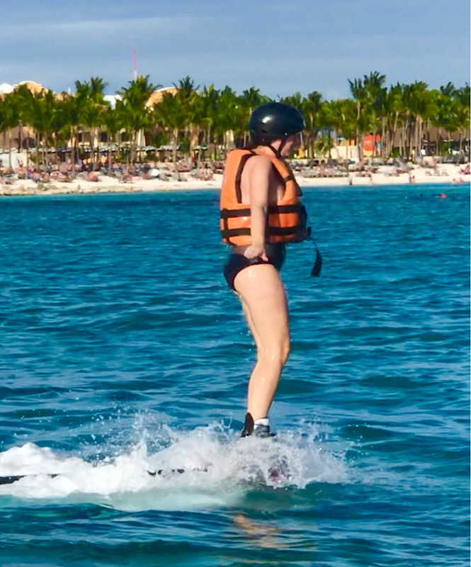 What is flyboarding? A review featured by top family travel blog, More Than Main Street: image of a woman flyboarding for the first time.