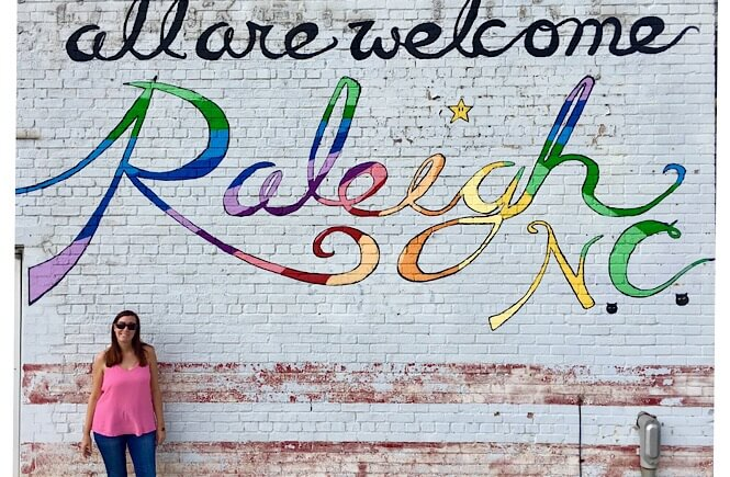 5 Weekend Getaways in NC for Family featured by top NC travel blog, More Than Main Street: All are Welcome mural in Raleigh NC