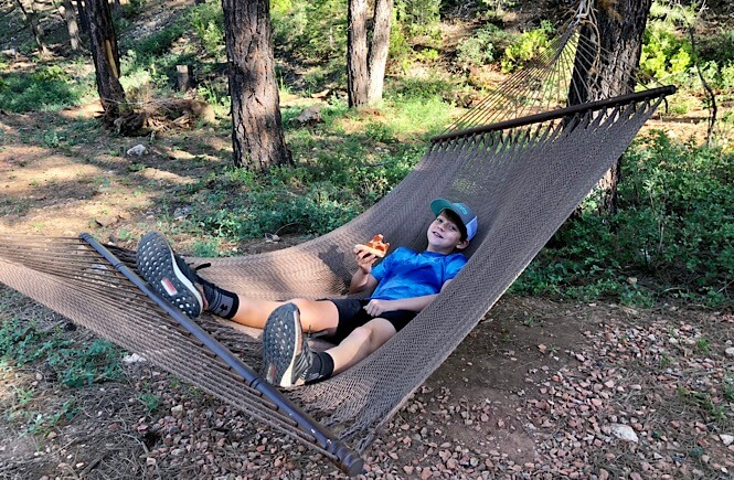 Bryce Canyon Glamping experience featured by top US family travel blog, More Than Main Street: image of   Dinner in the hammock...not too shabby!