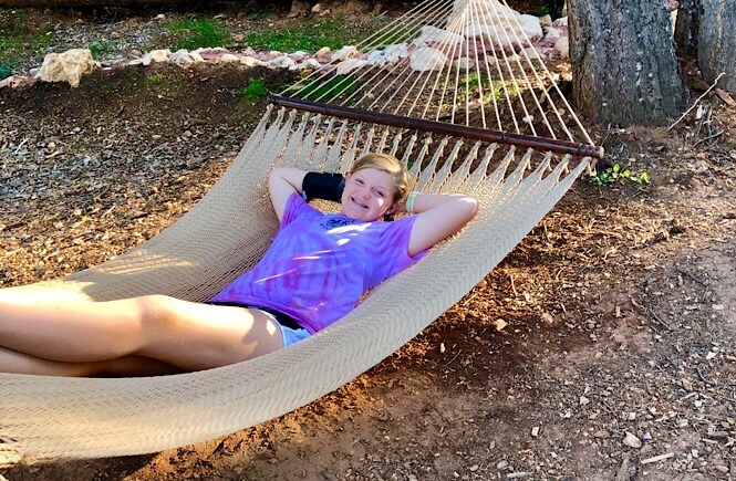 Bryce Canyon Glamping experience featured by top US family travel blog, More Than Main Street: image of Relaxing in our hammock!