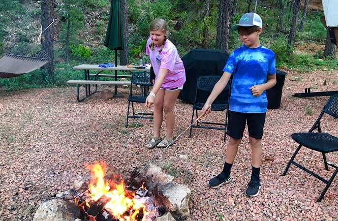 Bryce Canyon Glamping experience featured by top US family travel blog, More Than Main Street: image of   Making s'mores at Whispering Pines!