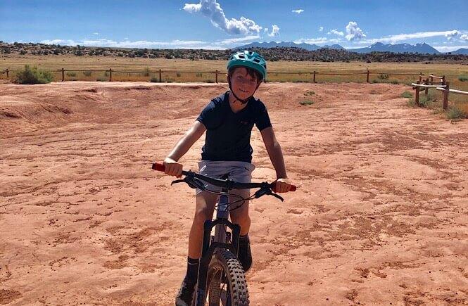 2 Week Utah Arizona road trip featured by top US family travel blog, More Than Main Street: image of Mountain Biking in Moab, Utah!
