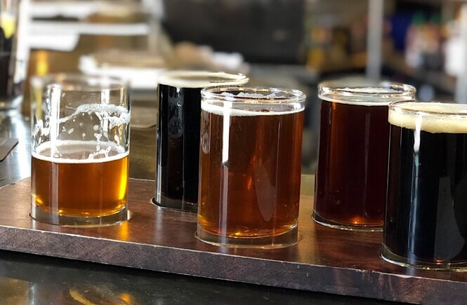 The Ultimate Denver Itinerary featured by top US family travel blog, More Than Main Street: flight of beer at Wynkoop Brewery