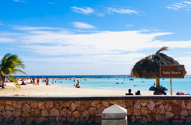 Best tips for international travel with children featured by top US family travel blog, More than Main Street; Baby Beach in Aruba!