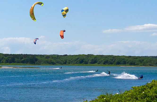 The perfect itinerary for a day trip to Martha's Vineyard from Falmouth MA featured by US family travel blog, More than Main Street; kite surfing.