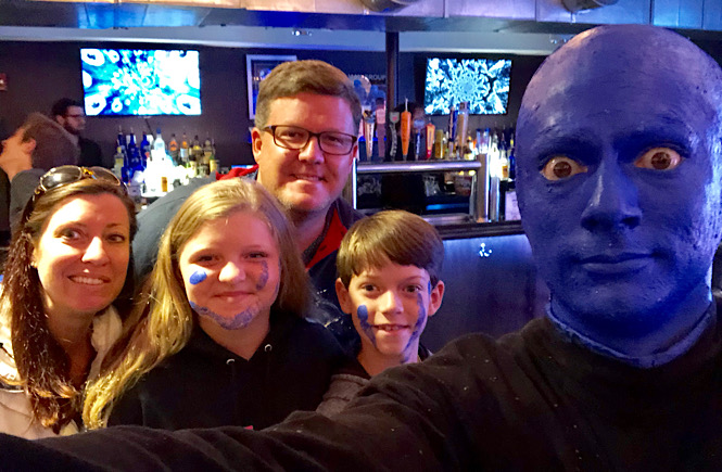 Boston to Niagara Falls road trip itinerary featured by top US family travel blog, More than Main Street: image of Blue Man Group in Boston, Massachusetts.