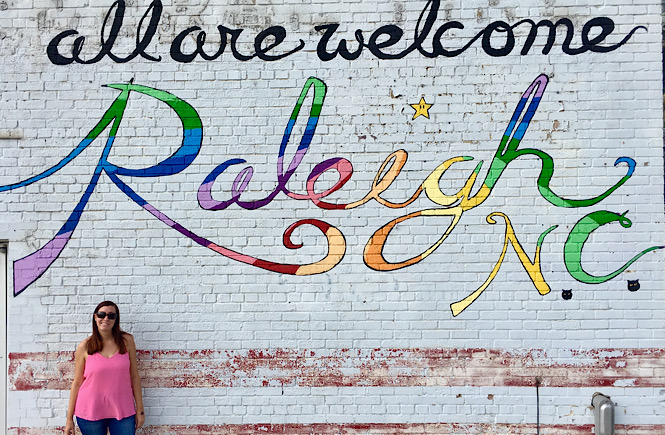 Top 10 Raleigh NC Murals to Visit with your Family featured by top US travel blog More than Main Street: All are Welcome mural.