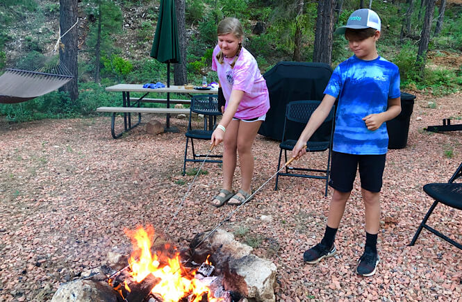 Top 10 Stay At Home Adventures for Your Family featured by top lifestyle and US travel blog, More than Main Street; smores by the campfire!