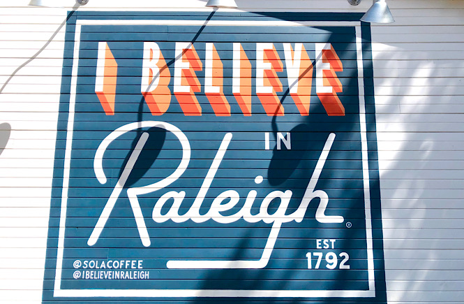 I Believe in Raleigh mural at Sola Coffee Cafe in Raleigh NC along with ten other fun pieces of street art in the Triangle area of NC.