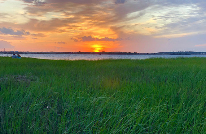 Sunset over the Cape Fear River at Fort Fisher, NC. Photo by US travel blog More than Main Street.
