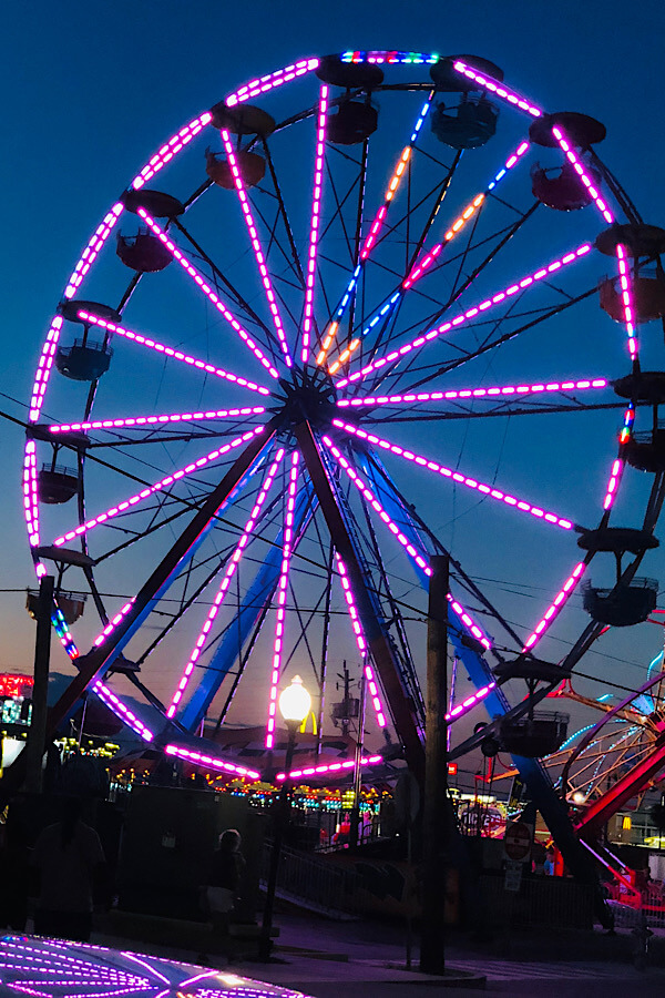 Top 10 best things to do in Carolina Beach and Kure Beach NC featured by top US travel blog, More than Main Street: Ferris wheel on Carolina Beach boardwalk.
