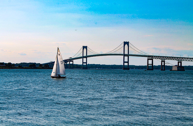 Newport Rhode Island bridge and sailboat- the perfect east coast destination for families.