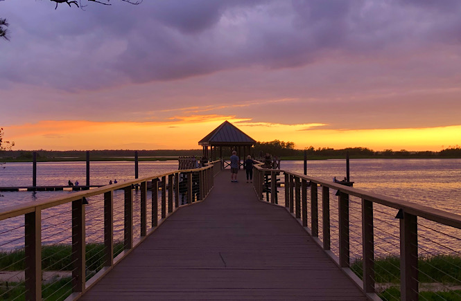 River Lights Boardwalk is one of the Top 5 Best Places to Watch the Sunset in Wilmington NC featured by top US travel blog, More than Main Street.
