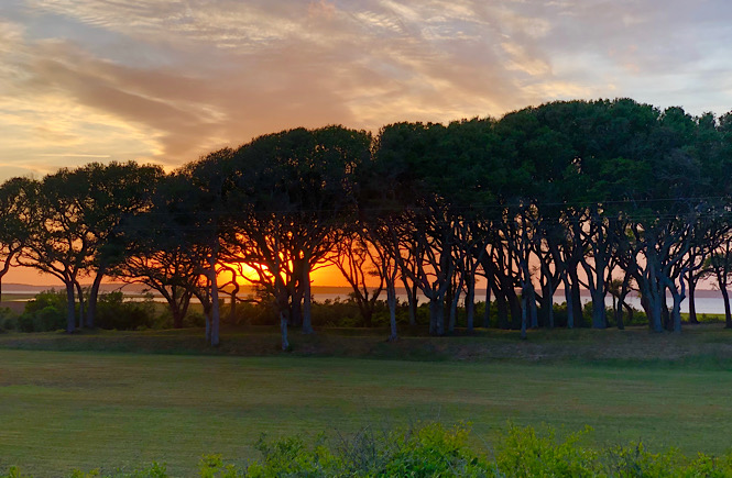 Top 5 Best Places to Watch the Sunset in Wilmington NC featured by top US travel blog, More than Main Street. (Historic Area at Fort Fisher)