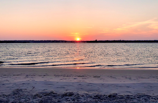 The South End of Wrightsville Beach is is one of the Top 5 Best Places to Watch the Sunset in Wilmington NC featured by top US travel blog, More than Main Street.