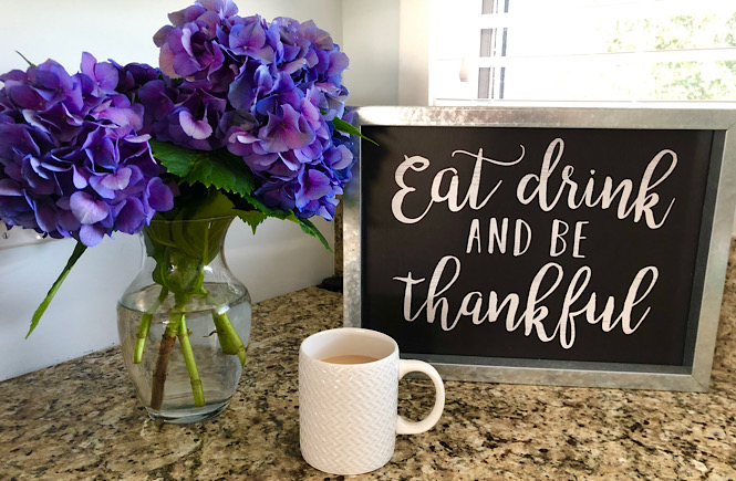 Being Grateful: 100 Unique Things to Be Thankful for featured by top lifestyle blog, More than Main Street. Image of hydrangeas, coffee, and sign that says eat, drink, and be thankful.