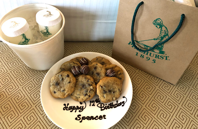 Top 10 Best Things to Do in Pinehurst NC featured by top US travel blog, More than Main Street: image of cookies, milk, and birthday gift from the Pinehurst Resort at the Carolina Hotel.