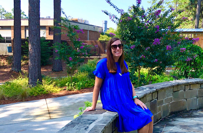 Top 10 Best Things to Do in Pinehurst North Carolina on Your Next Family Vacation featured by top US travel blog, More than Main Street: image of girl at Sandhills Community College gardens.