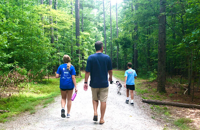 Family going on a nature walk to practice mindfulness together.