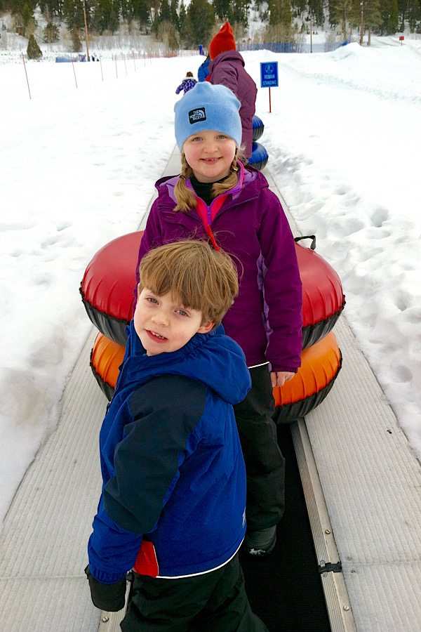 Two kids getting ready to go snow tubing!! Add this to your winter bucket list!