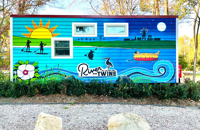 River and Twine tiny house hotel mural featured by top US family travel blog, More than Main Street.