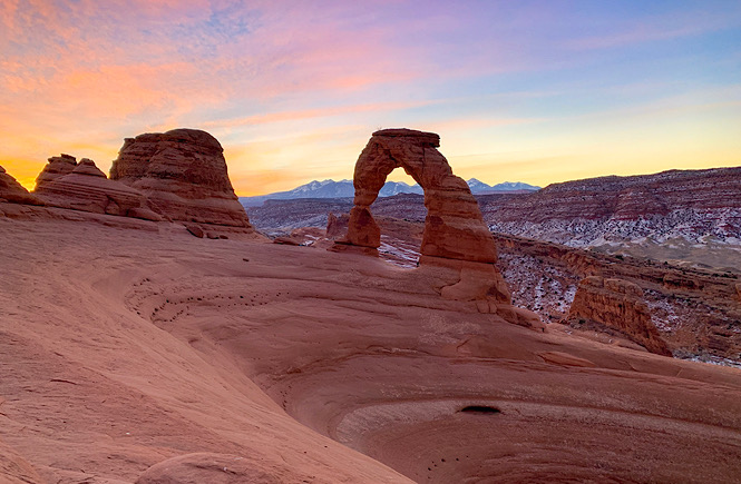 Arches National Park at Sunset is a bucket list item for adventure seekers.