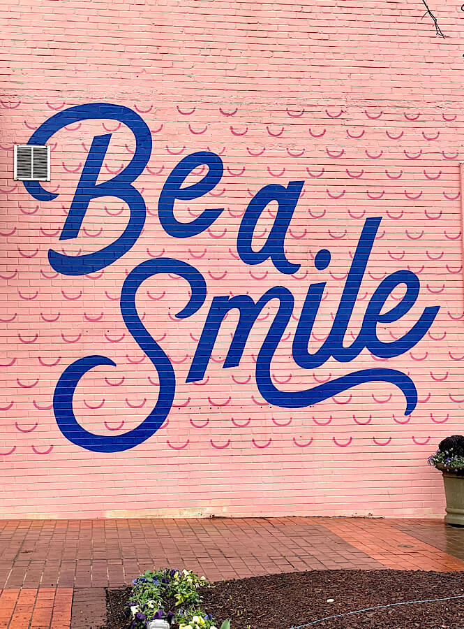 Be a smile mural at Cameron Village in Raleigh NC.
