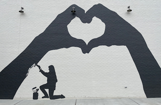 Heart hands mural by Crumbl cookies in Raleigh NC.