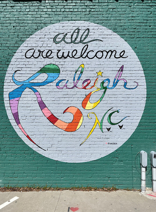 All are Welcome Mural in downtown Raleigh photographed by NC blogger, More than Main Street.