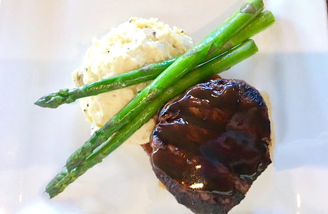 Steak, mashed potatoes and asparagus from Bridge Tender in Wilmington NC featured by top NC travel blog, More than Main Street.