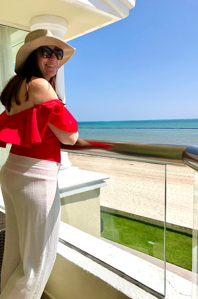 Girl on the balcony of the oceanfront room in the Nizuc section of the Moon Palace.