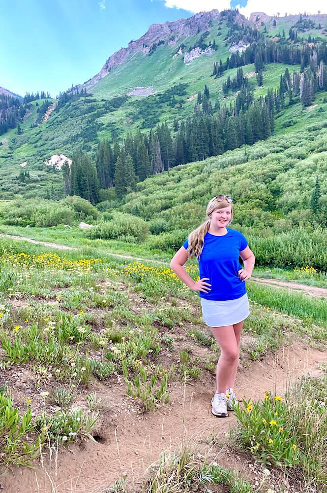 Teenager girl hiking in Utah Wasatch Mountains- Alta Ski Resort.