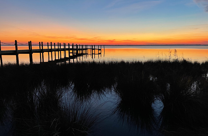 A weekend getaway to the Outer Banks isn't complete without a Duck sunset!